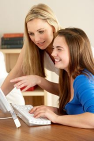 mother_helping_daughter_at_computer-resized-188