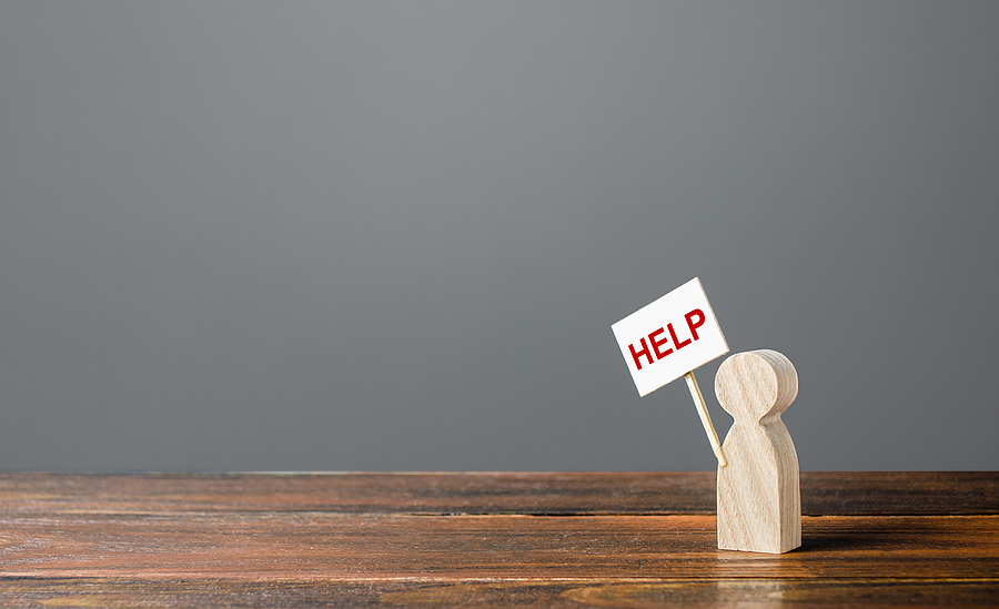 FAQ-A-Human-Figurine-Asking-For-Help